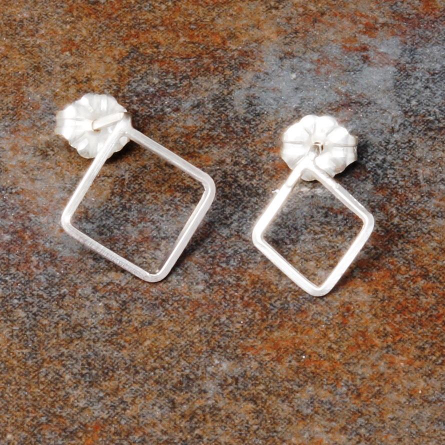 Handmade Asymmetric sterling silver diamond studs