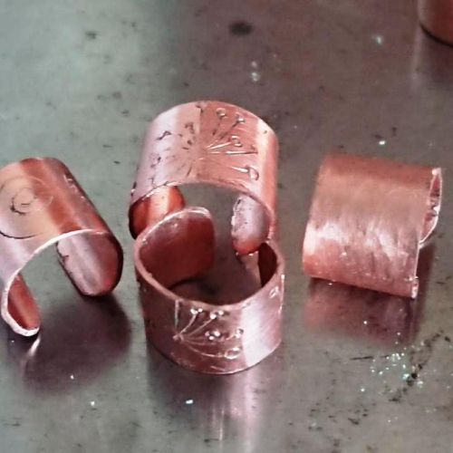 Handmade copper textured and stamped ear cuffs